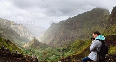 Traveler in front of motion landscape. Deep clouds above green Xo-Xo Valley. Santo Antao Island