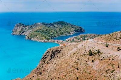 Top view of Assos village located in cute bay on beautiful blue sea coastline, Kefalonia island