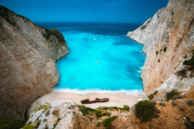 Shipwreck in Navagio beach. Azure turquoise sea water and paradise sandy beach. Famous tourist