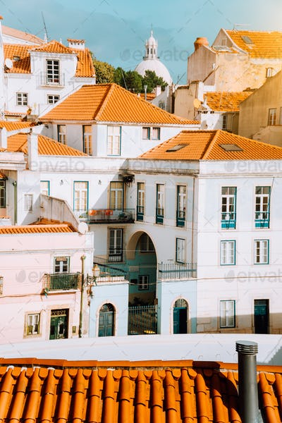 Colorful red and white citycape of Lisbon. Historical downtown built on the side of the hill. Bright