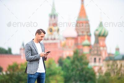 Happy young urban man in european city