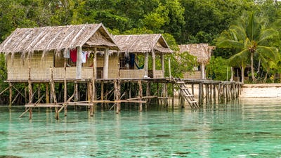 Bamboo Huts on wooden Stocks of an Homestay, Gam Island, West Papuan, Raja Ampat, Indonesia