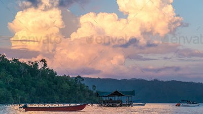 Huge White Clouds above Diving Station on Sunset, Homestay Gam Island, West Papuan, Raja Ampat