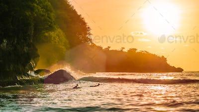 Surf on sunset on beautiful Crystal Bay, Nusa Penida, Bali, Indonesia