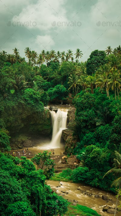 Tegenungan Waterfall. Ubud in Bali, Indonesia. Vertical orientation