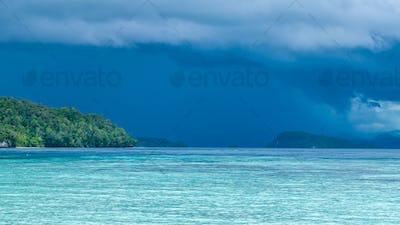 Beautiful Blue Lagoone shortly before Thunderstorm, Gam Island, West Papuan, Raja Ampat, Indonesia