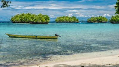 Papua Local Boat, Beautiful Blue Lagoone near Kordiris Homestay, Small Green Island in Background