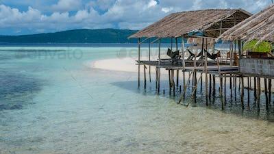 Water Hut of Homestay on Sandy Bank - Kri Island. Raja Ampat, Indonesia, West Papua
