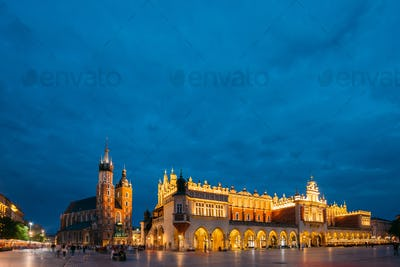 Krakow, Poland. Evening Night View Of St. Mary's Basilica And Cl