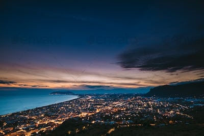 Terracina, Italy. Top View Skyline Cityscape City In Evening Nig