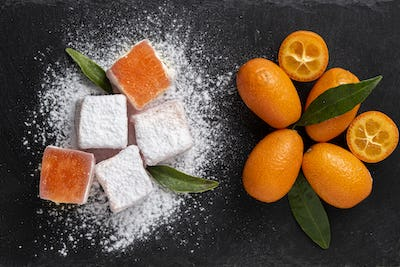 Turkish delights with kumquat flavour on a dark stone