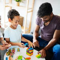 Family time. Young black parents with two kids playing together at home
