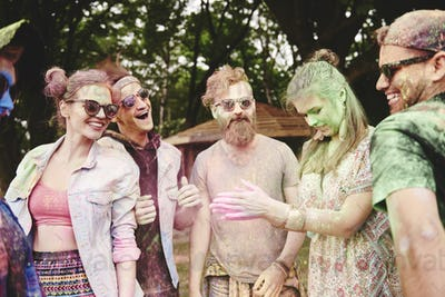 Friends are happy at the holi festival