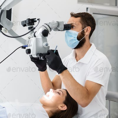 Highly qualified dentist using modern technologies in treatment