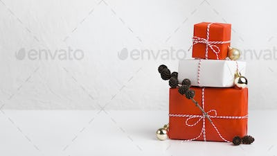 Gift boxes of red and white paper decorated by cones