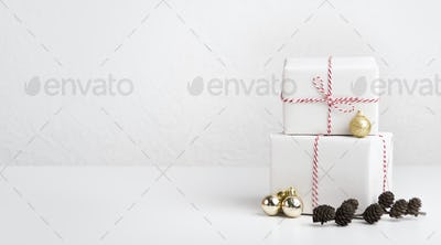 Creative greeting card with present boxes and cones on white
