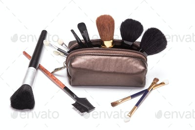 Makeup case with make-up brushes and applicators