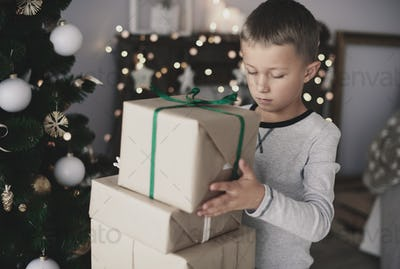 Child arranging gift on the top of the other