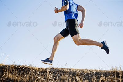 male runner running mountain trail