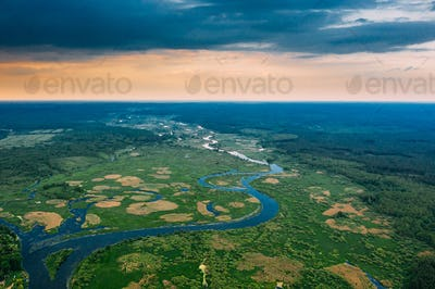 Aerial View. Sunset Sky Above Green Forest, Meadow And River Lan