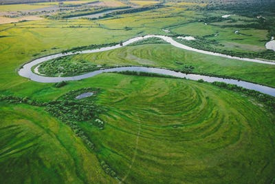 Aerial View Green Meadow And River Landscape In Sunny Spring Eve