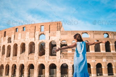 Young female tourist looking at the Colosseum outside in Rome, Italy