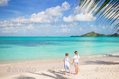 Adorable little girls walking on the beach