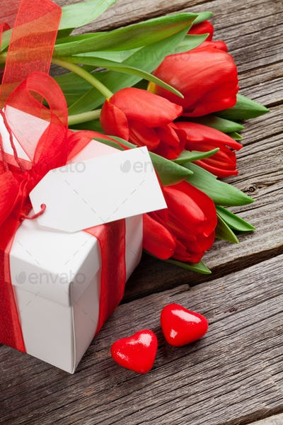Valentines day gift box and red tulips