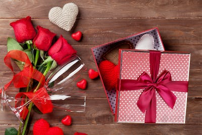 Valentines day gift box, roses, and champagne glasses