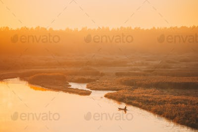 Calm Lake, River And Single Rowing Fishing Boat During Beautiful