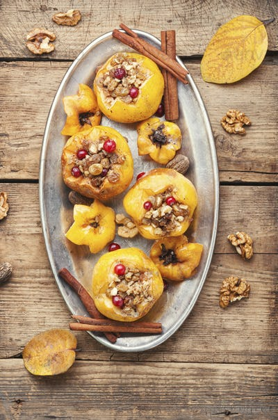 Baked quince stuffed with nuts