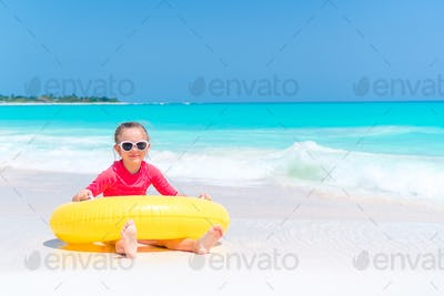 Adorable little girl having fun on the beach