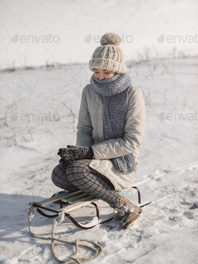 Woman with Sled Outdoors