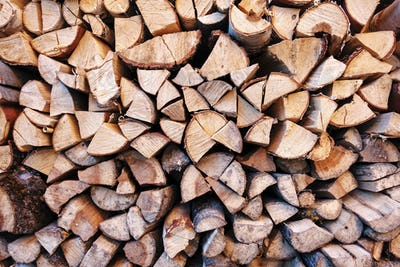Background texture of chopped wood in a stack