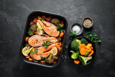 Salmon. Baked salmon fish steaks with vegetables, broccoli, carrot and onion