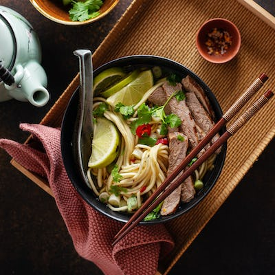 Tasty asian classic soup with noodles and meat