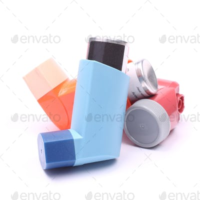 Asthma inhalers isolated over white