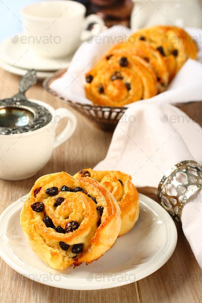 Fresh gluten free sweet swirl buns with raisins