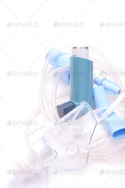 Asthma inhalers with inhalation mask over white