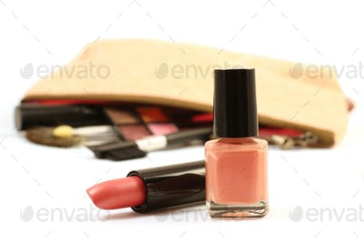 Pink lipstick and nail polish isolated over white