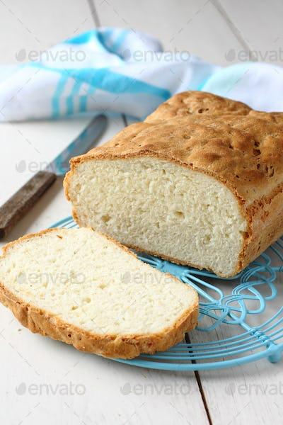 Homemade gluten free bread on blue metal grid