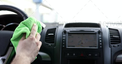 Hand cleaning car steering wheel with microfiber cloth