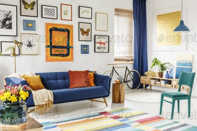 Spacious living room interior with a blanket and orange pillows