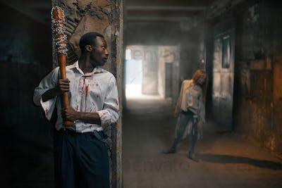 Man with baseball bat prepares to kill zombie