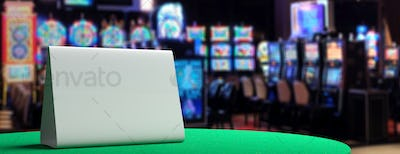Blank metal sign on a casino table, blur slot machines background. 3d illustration