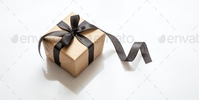 Gift box with black ribbon isolated against white background, Black Friday concept.