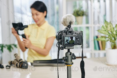 Blogger reviewing video production equipment