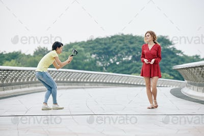 Woman filming walking blogger