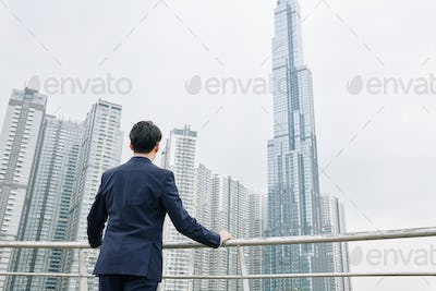 Entrepreneur looking at skyscrapers