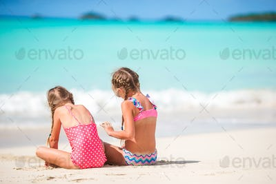 Adorable little girls walking on the beach